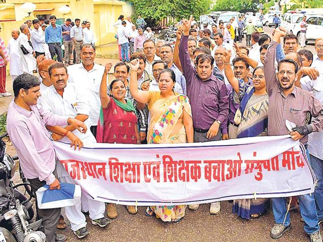 Teachers-stage-a-demonstration-outside-the-residence-of-education-minister-Vasudev-Devnani-against-the-new-staffing-pattern-in-government-schools-in-Jaipur-on-Monday-HT-Photo