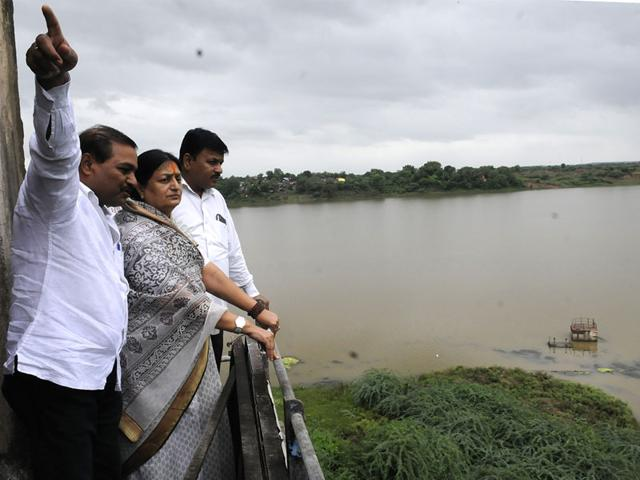 Indore-mayor-Malini-Gaud-and-senior-municipal-officials-review-Narmada-projects-in-Jalud-village-of-Khargone-district-on-Monday-Shankar-Mourya-HT-photo