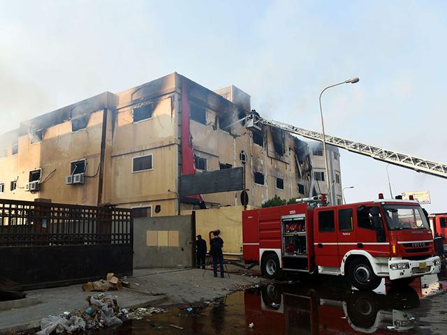 Egyptian-firemen-put-out-the-flames-after-a-fire-broke-out-at-the-Al-Helw-furniture-factory-north-of-the-Capital-Cairo-AFP-Photo