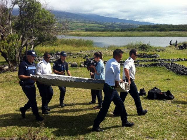 Investigators-from-France-s-air-crash-agency-find-debris-that-is-almost-certainly-from-a-Boeing-777-sparking-hopes-that-the-remains-of-Malaysia-Airlines-flight-MH370-which-disappeared-last-year-may-have-been-found-AFP-Photo