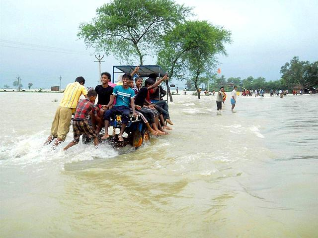Locals-wade-through-flooded-road-in-West-Bengal-s-Burdwan-district-PTI-Photo