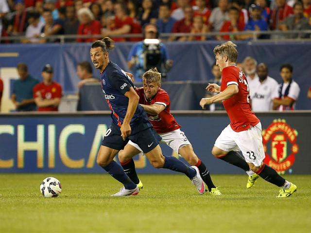 Paris-Saint-Germain-PSG-forward-Zlatan-Ibrahimovic-left-controls-the-ball-against-Manchester-United-defender-Luke-Shaw-centre-and-defender-Bastian-Schweinsteiger-during-the-second-half-of-their-International-Champions-Cup-soccer-game-at-Soldier-Field-in-Chicago-Illinois-on-July-29-2015-PSG-won-2-0-AFP-Photo