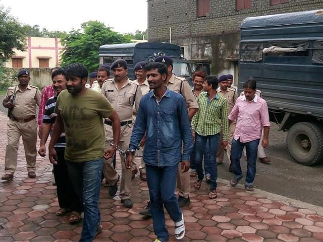 Accused-in-property-dealer-Rajesh-Jain-s-abduction-are-escorted-by-police-to-a-court-in-Khandwa-on-Wednesday-HT-photo