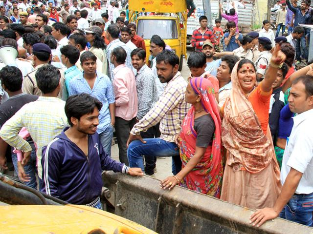 Residents-protest-against-IMC-s-encroachment-removal-drive-on-Roshan-Singh-Bhandari-Marg-near-Zanzeerwala-Square-in-Indore-on-Thursday-Arun-Mondhe-HT