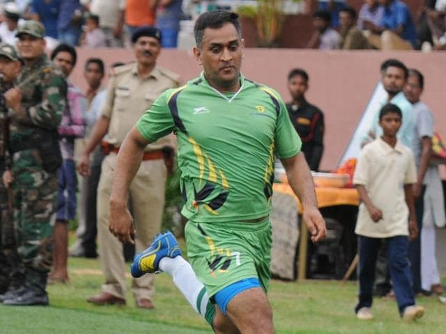 Indian-ODI-team-captain-MS-Dhoni-was-seen-in-action-during-an-exhibition-football-match-being-played-at-the-football-stadium-in-Silli-near-Ranchi-Jharkhand-Parwaz-Khan-HT-Photo
