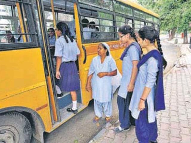 Lady-attendant-deployed-Government-Model-school-Sector-10-guiding-the-students-as-they-board-the-bus-in-Chandigarh-on-Thursday-Ravi-Kumar-HT