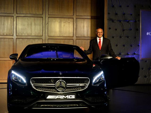 Managing-Director-and-CEO-of-Mercedes-Benz-India-Eberhard-Kern-poses-alongside-a-Mercedes-Benz-AMG-S-63-Coupe-during-a-launch-ceremony-in-New-Delhi-on-July-30-2015-Mercedes-Benz-India-have-launched-three-highly-luxurious-cars-S500-Coupe-AMG-S63-Coupe-and-AMG-G-63-crazy-colour-edition-Photo-AFP