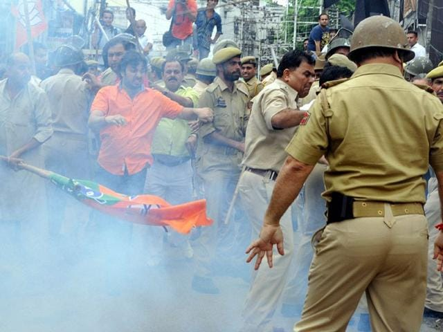 Police-perssonel-using-smoke-shell-to-disperse-BJP-workers-and-AIIMS-coordination-committee-members-during-a-clash-outside-the-BJP-office-during-a-three-days-strike-in-Jammu-on-Friday-Nitin-Kanotra-HT-Photo