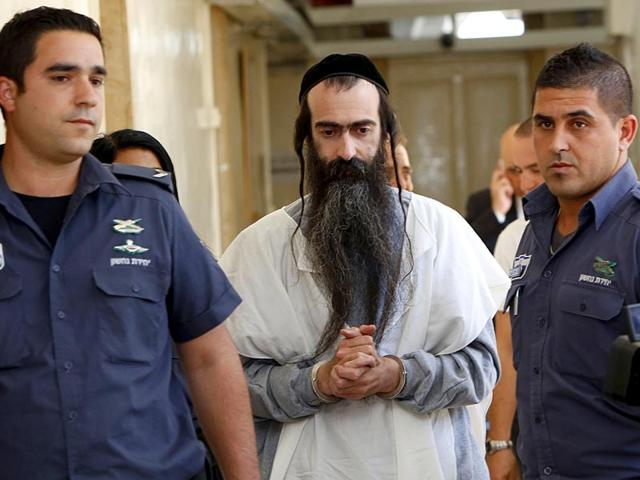 Israeli-ultra-orthodox-Yishai-Shlissel-C-suspected-of-stabbing-six-Gay-Pride-marchers-the-previous-day-is-brought-handcuffed-to-the-Jerusalem-Magistrate-s-Court-on-July-31-2015-AFP-Photo