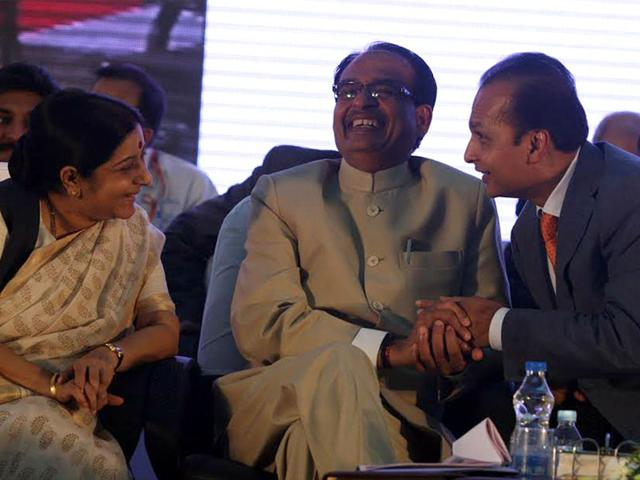 CM-Shivraj-Singh-Chouhan-with-industrialist-Anil-Ambani-and-Sushma-Swaraj-at-a-Global-Investors-Summit-HT-file-photo