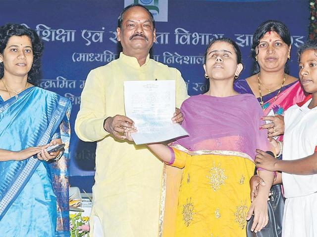 Jharkhand-chief-minister-Raghubar-Das-hands-over-appointment-letter-to-a-teacher-at-a-function-in-Ranchi-on-Thursday-Parwaz-Khan-HT-photo