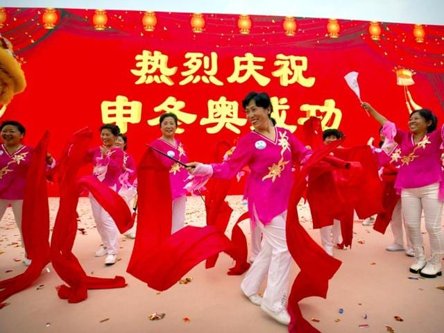Celebrations-begin-outside-the-Beijing-Olympic-Stadium-also-known-as-the-Bird-s-Nest-in-Beijing-on-July-31-2015-following-the-announcement-that-the-city-will-host-the-2022-Winter-Olympics-The-sign-reads-Warm-celebration-of-the-successful-Winter-Olympics-bid-AP-Photo