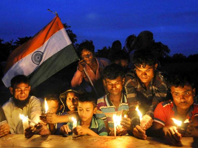 Dwellers-light-candles-at-Madhya-Mashaldanga-enclave-Cooch-Behar-during-the-zero-hour-celebration-Historic-exchange-of-enclaves-between-India-and-Bangladesh-was-made-at-midnight-on-July-31-2015-Subhendu-Ghosh-HT-Photo