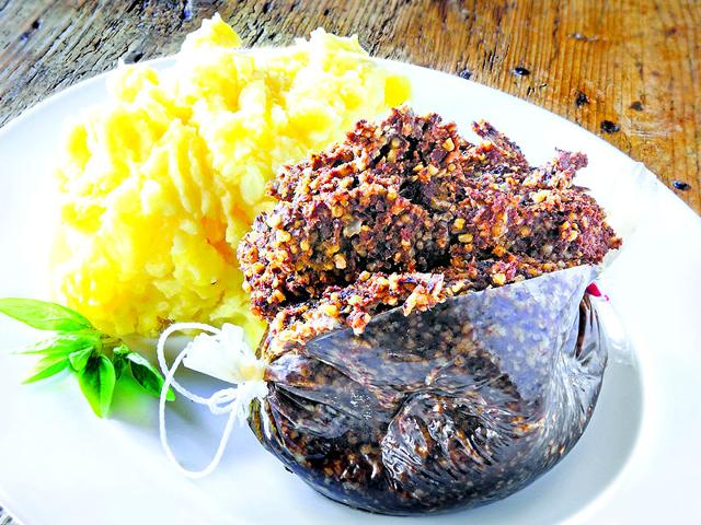Haggis-is-a-traditional-Scottish-savoury-pudding-made-of-sheep-stomach-stuffed-with-its-heart-liver-and-lungs-Photo-iStock