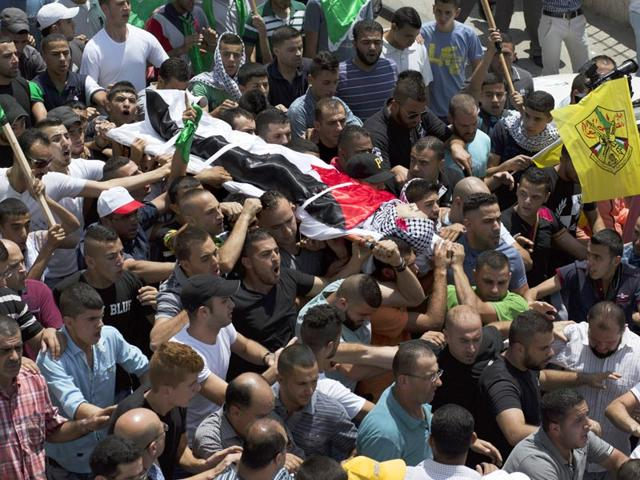 Mourners-carry-the-body-of-Palestinian-youth-Laith-al-Khaldi-who-was-killed-during-clashes-with-Israeli-troops-over-the-killing-of-a-Palestinian-toddler-by-suspected-Jewish-extremists-AP-Photo
