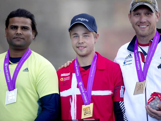 Indian-silver-medallist-Rajat-Chauhan-L-gold-medallist-Stepan-Hansen-C-and-British-bronze-winner-Adam-Ravenscroft-celebrate-after-the-Men-s-Compound-Finals-at-World-Archery-in-Copenhagen-AP-Photo