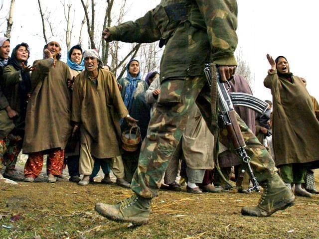 Kashmiri-women-shout-at-passing-soldiers-during-a-protest-in-2004-Reuters
