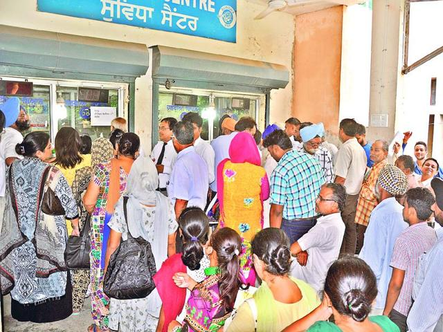 People-waiting-in-long-queue-s-at-the-Suwidha-centre-n-the-backside-of-Bachat-Bhawan-at-the-mini-secretariat-in-Ludhiana-Sikandar-Singh-Chopra-HT-Photo