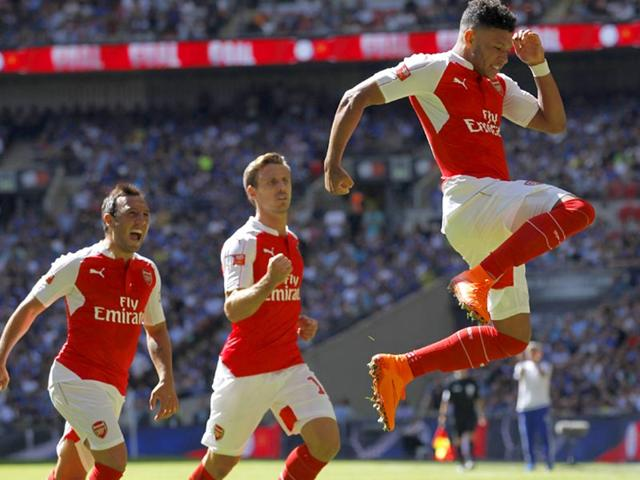 Arsenal-s-English-midfielder-Alex-Oxlade-Chamberlain-R-celebrates-scoring-the-opening-goal-of-the-FA-Community-Shield-football-match-between-Arsenal-and-Chelsea-at-Wembley-Stadium-in-London-on-August-2-2015-Arsenal-won-1-0-AFP-Photo