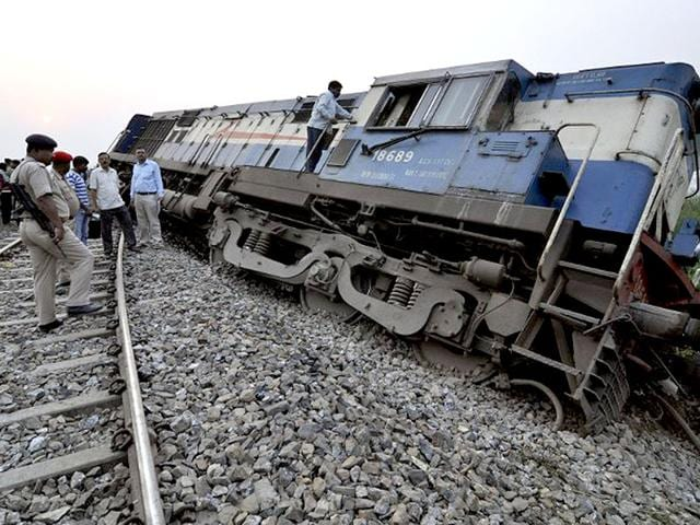 Railway-officials-and-security-personnel-are-pictured-at-the-scene-of-a-derailed-train-at-Teghria-village-near-Jagiroad-Rail-Station-in-Morigaon-district-some-90-kms-from-Guwahati-in-India-s-northeastern-state-of-Assam-on-April-16-2014-Over-50-passengers-were-injured-in-the-accident-Northeast-Frontier-Railway-sources-said-AFP-Photo