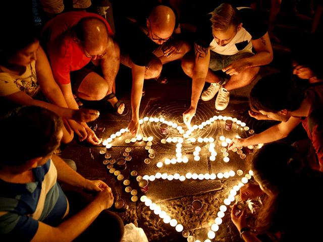 People-light-candles-during-a-gathering-of-hundreds-of-friends-classmates-teachers-members-of-the-gay-community-and-supporters-in-downtown-Jerusalem-to-mourn-the-death-of-Shira-Banki-who-was-stabbed-at-the-Jerusalem-Gay-Pride-march-AFP-Photo