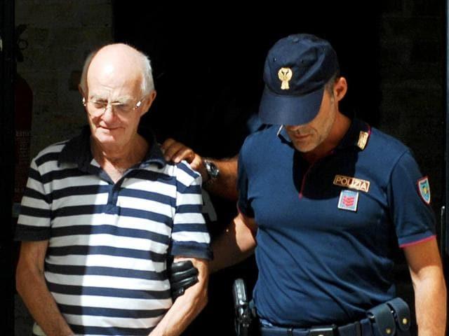 An-Italian-police-officer-takes-in-custody-Ugo-Di-Leonardo-left-one-of-the-11-men-suspected-of-helping-No-1-Cosa-Nostra-fugitive-Matteo-Messina-Denaro-in-Palermo-Italy-AP-Photo-Alessandro-Fucarini