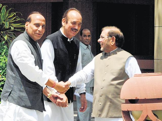 Home-minister-Rajnath-Singh-with-Leader-of-opposition-in-RS-Ghulam-Nabi-Azad-and-JD-U-chief-Sharad-Yadav-in-New-Delhi-Sonu-Mehta-HT-Photo