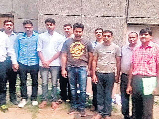 Arrested-racketeers-Sunil-Panwar-blue-shirt-Mohammad-Juber-white-shirt-Ranchit-Khurana-deep-grey-t-shirt-and-Praveen-Jha-light-grey-t-shirt-in-police-custody-File-photo