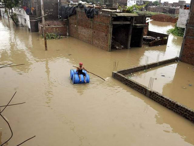 Rainwater-submerged-houses-in-Indore-s-New-Bajrangpura-on-Wednesday-People-had-to-climb-upstairs-and-stay-put-till-the-water-receded-Arun-Mondhe-HT