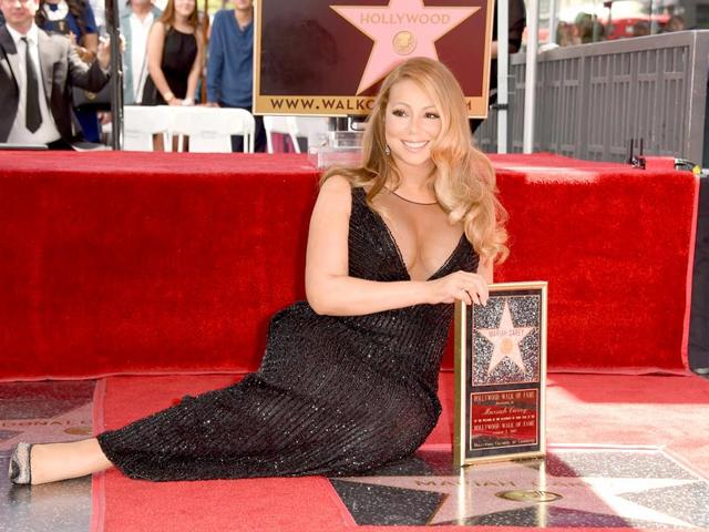 Best-selling artiste Mariah Carey was honoured with a star on The Hollywood Walk of Fame on August 5, 2015. (AFP)