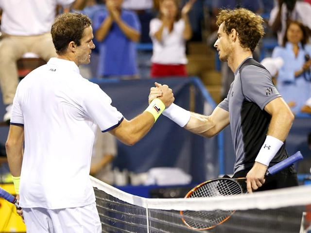 Teymuraz-Gabashvili-left-shakes-hands-with-Andy-Murray-after-beating-him-on-Day-three-of-the-2015-Citi-Open-in-Washington-DC-on-August-5-2015-Gabashvili-won-6-4-4-6-7-6-4-Reuters-Photo