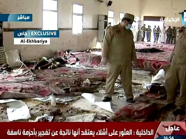 An-image-grab-taken-from-Saudi-Al-Ekhbaria-TV-on-August-6-2015-shows-Saudi-security-forces-inspecting-the-site-of-an-explosion-which-was-reported-triggered-by-a-suicide-bomber-at-a-mosque-located-inside-a-special-forces-headquarters-in-the-city-of-Abha-in-the-southern-province-of-Asir-near-the-border-with-Yemen-AFP-PHOTO-HO-AL-EKHBARIA