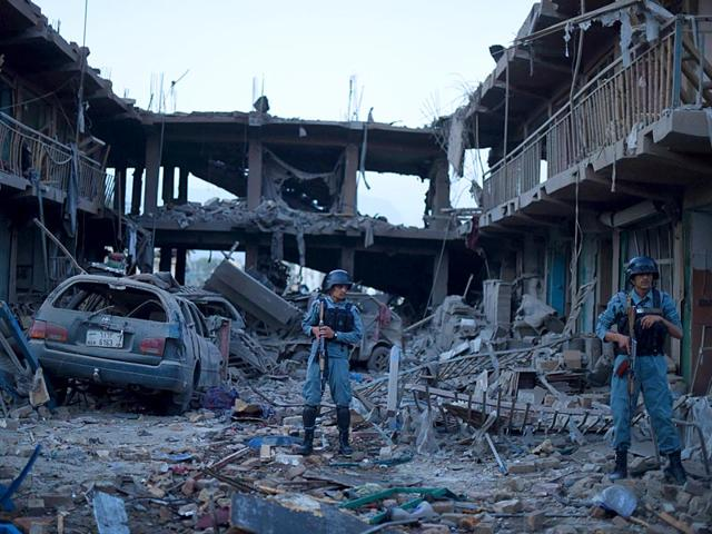 Afghans-work-the-site-of-a-car-bomb-attack-in-Kabul-Afghanistan-Friday-Aug-7-2015-A-bomb-hidden-in-a-truck-exploded-in-the-center-of-the-Afghan-capital-killing-several-people-and-wounding-hundreds-police-and-health-officials-AP-Photo