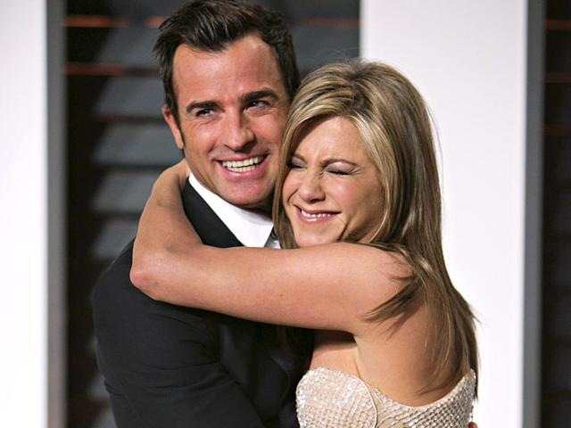 Jennifer-Aniston-and-Justin-Theroux-arrive-for-the-2015-Vanity-Fair-Oscar-Party-in-Beverly-Hills-California-in-this-February-22-2015-file-photo-Celebrity-magazine-People-reports-on-August-6-2015-that-the-couple-married-in-a-private-wedding-on-August-5-AFP-PHOTO-ADRIAN-SANCHEZ-GONZALEZ-FILES