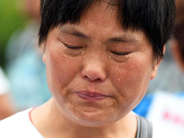 A-relative-of-a-passenger-on-the-missing-Malaysia-Airlines-MH370-cries-while-waiting-for-a-meeting-with-Malaysian-officials-in-Beijing-AFP-Photo