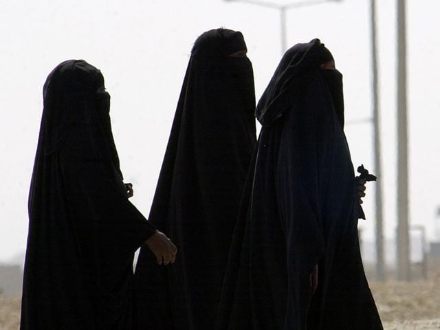 A-file-photo-of-Saudi-women-walking-along-a-suburban-street-in-Riyadh-Saudi-Arabia-AP-Photo