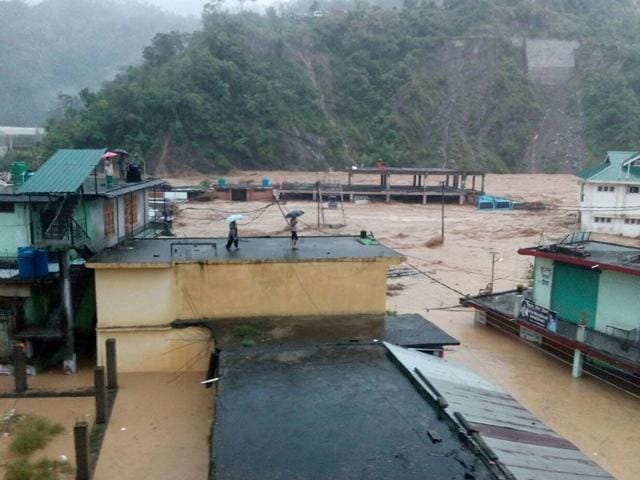 Buildings-submerged-after-the-Sone-rivulet-spilled-over-its-banks-as-a-cloudburst-triggered-flashfloods-in-Dharampur-town-of-Mandi-district-in-Himachal-Pradesh-on-Saturday-HT-Photo
