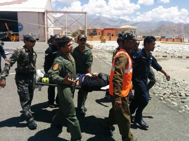 Indian-Air-Force-personnel-rush-Israeli-adventurer-Roei-Sadan-to-a-hospital-in-Leh-after-rescuing-him-from-the-Stok-range-IAF-photo