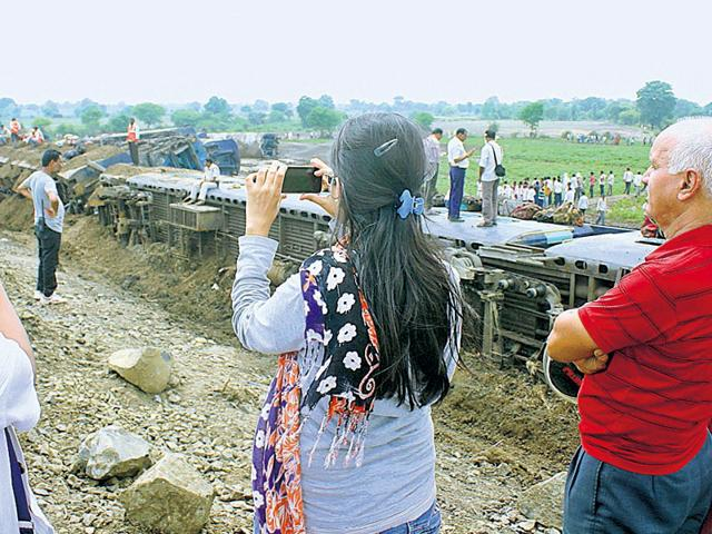 Youngsters-click-photos-at-the-train-derailment-spot-in-Harda-district-Bidesh-Manna-HT-Photo