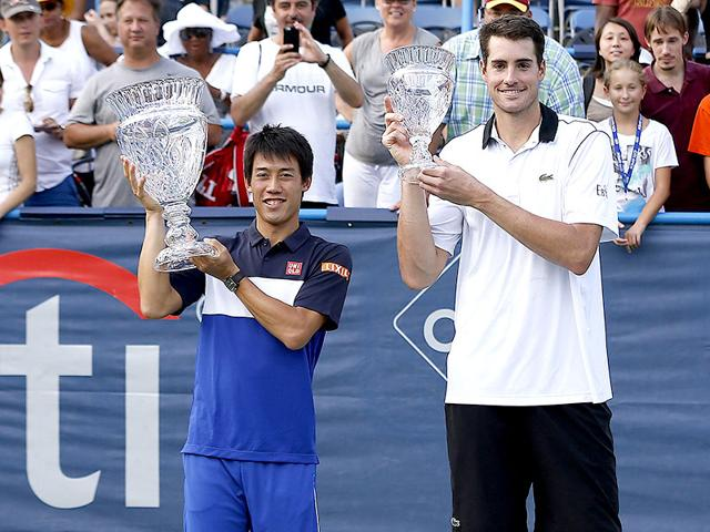 Japan-s-Kei-Nishikori-left-and-John-Isner-of-the-USA-pose-with-the-championship-and-runner-up-trophies-respectively-after-their-men-s-singles-final-of-the-2015-Citi-Open-in-Washington-DC-on-August-9-2015-Nishikori-won-4-6-6-4-6-4-Reuters-Photo