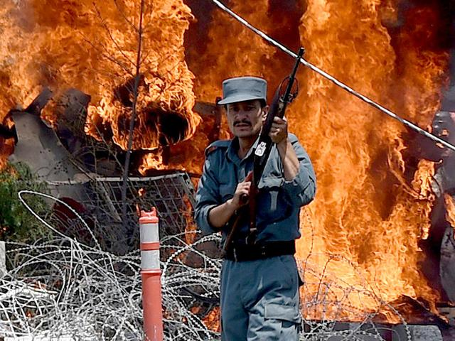 An-Afghan-policeman-keeps-watch-at-the-site-of-a-bomb-blast-in-Kabul-AFP-Photo