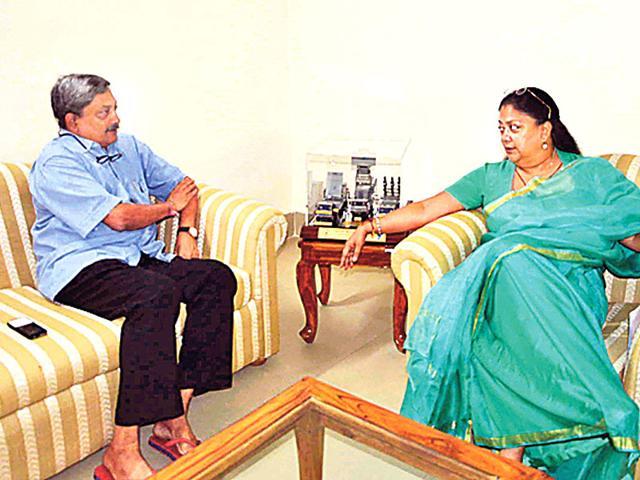 Chief-minister-Vasundhara-Raje-meets-defence-minister-Manohar-Parikkar-at-latter-s-residence-in-Delhi-on-Sunday-HT-Photo