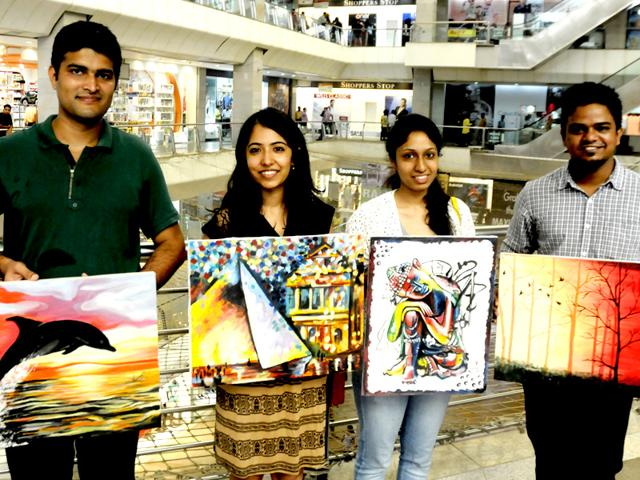 Several-students-of-IIM-Lucknow-flocked-to-Fun-Republic-Mall-on-Sunday-and-sold-their--paintings-to-help-the-girl-child-The-exercise-was-also-aimed-at-helping-students-learn-the-art-of-negotiation-Lucknowites-happily-opened-their-wallets-for-amateur-paintings-made-by-budding-managers-Photo-by-Deepak-Gupta