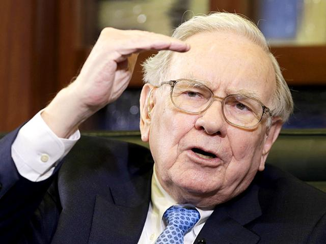Berkshire-Hathaway-Chairman-and-CEO-Warren-Buffett-speaks-during-an-interview-with-Liz-Claman-on-the-Fox-Business-Network-in-Omaha-Buffett-s-Berkshire-Hathaway-is-buying-Precision-Castparts-Corp-for-approximately-37-36-billion-AP-Photo