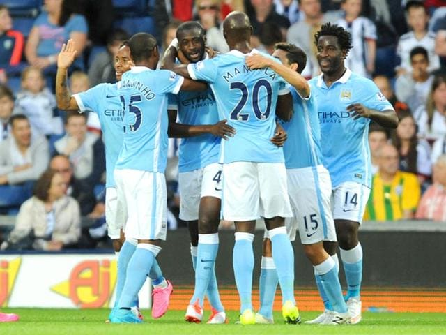 Manchester-City-s-Yaya-Toure-third-from-left-is-congratulated-by-teammates-after-scoring-against-West-Bromwich-Albion-during-the-English-Premier-League-EPL-match-between-the-two-sides-at-the-Hawthorns-West-Bromwich-England-on-August-10-2015-AP-Photo