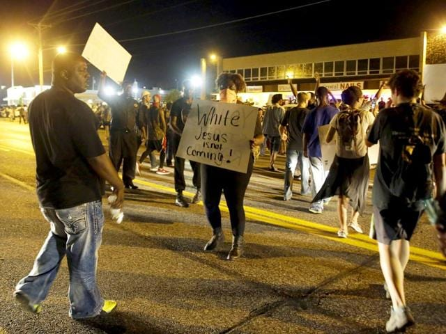 Crowds-chant-in-the-street-along-West-Florissant-Avenue-Monday-Aug-10-2015-in-Ferguson-Missouri-Ferguson-was-a-community-on-edge-again-Monday-a-day-after-a-protest-marking-the-anniversary-of-Michael-Brown-s-death-was-punctuated-with-gunshots-AP-Photo