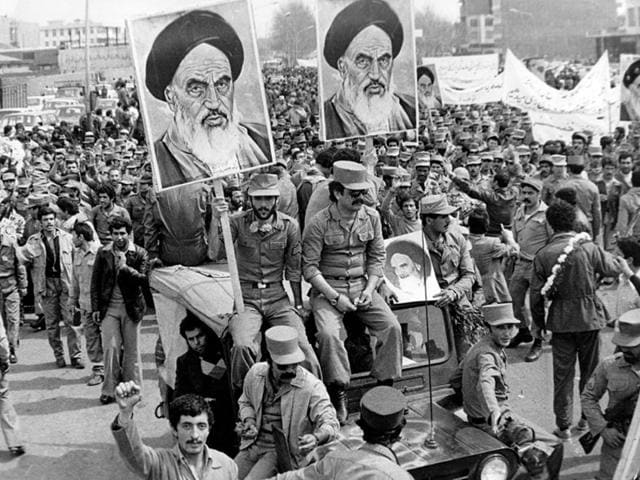 The Iranian Islamic Republic Army with posters of Ayatollah Khomeini. In 1989, the Ayatollah issued a fatwa against Salman Rushdie over his novel, The Satanic Verses. (Getty images)