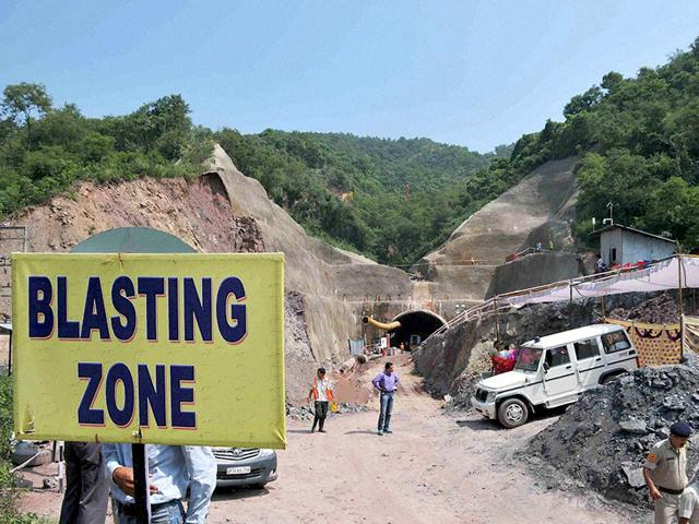 Three workers were trapped in the tunnel being built in the northern state of Himachal Pradesh after a cave-in blocked the entrance with tonnes of earth and boulders on September 12. (AFP Photo)