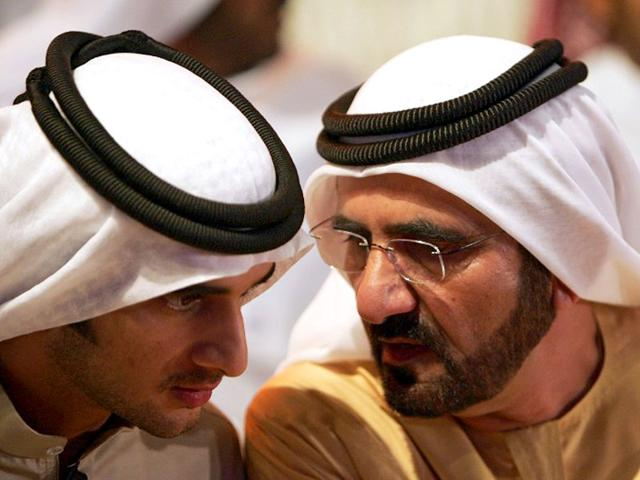 A file picture shows Sheikh Mohammad bin Rashid al-Maktoum (R), Ruler of Dubai and Prime Minister of the United Arab Emirates, speaking to his son Rashid during the launching of new initiative 'Dubai Cares', in Dubai. Sheikh Rashid died of a heart attack. (AFP Photo)