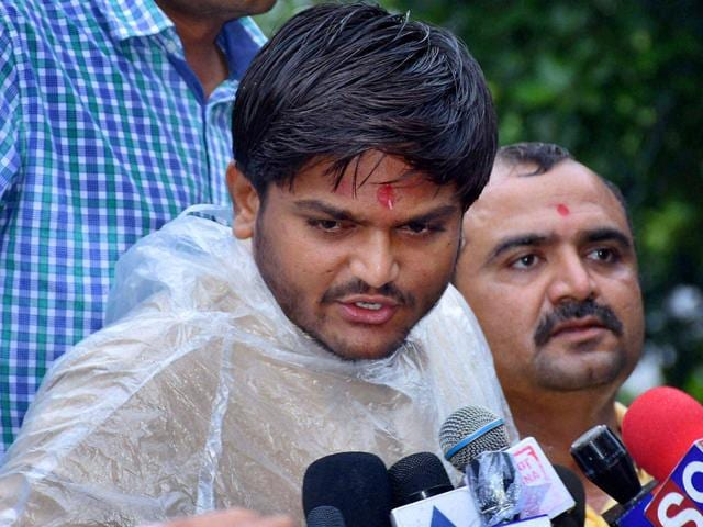 Patidar Anamat Andolan Samiti (PAAS) convener Hardik Patel speaks to the media after he was detained in Surat. (PTI Photo)